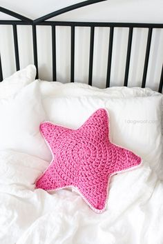 Crochet Sirius Star pillow using pink fabric or t-shirt yarn.
