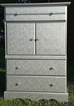 Wallpapered dresser and silver metallic paint.