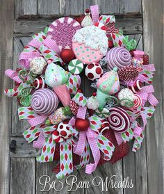 Candy Land Wreath, Candy Land Decor, Christmas Wreath, Christmas Decor, Holiday Wreath, Holiday Decor, Elf Wreath  Candy Land Christmas   It's the SWEETEST time of the year and this is a wreath I hope you hold dear~ as it brings about fondness of our childhood and those sugar plum fairy dreams that dance in our heads. Peppermints, Lollipops, Candies~ 'O My!!! I didn't not hold back on any details ~ just one look at this and you'll have to go to the dentist~ lol~ it is that SWEET! ...