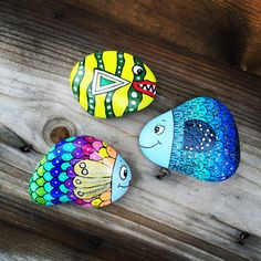 #JanniC..colorful fish painted on stone!