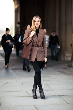 Gaia Repossi in a plaid belted blazer + black turtleneck + black trousers + leather ankle boots
