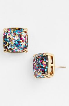 """Sparkly glitter shines through the clear stones of these girly, party-perfect stud earrings.  * 1/2"""" square.  * Post back.  * 14k-gold or rhodium plate/epoxy.  * By kate spade new york; imported.  * Item ships in a gift box."""