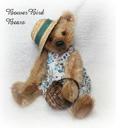 Phoebe approximately 14 inches high new style bear for 2016. She is made from distressed mohair and is wearing a hand made dress made from charming fabric covered with door mice and toadstools. Fully jointed with glass eyes. ADOPTED!