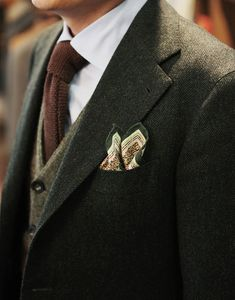 forest green herringbone tweed jacket, heather wool olive vest and brown wool tie . very nice. (don't like the pocket square, though)