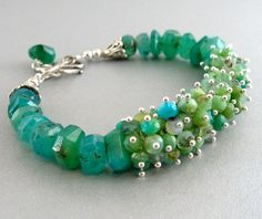 Peruvian Opal and Sterling Silver Cluster Bracelet. $350.00, via Etsy.