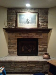 Brown stacked stone faced corner fireplace living room ideas pinterest home design corner - Fireplace finish ideas ...