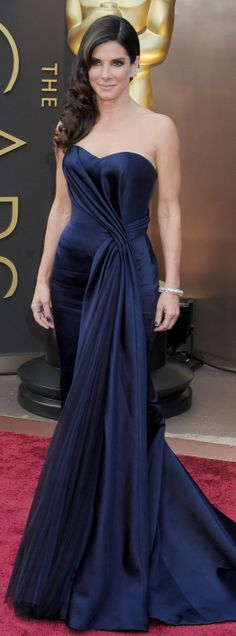 Sandra Bullock in Alexander McQueen - Oscars 2014.  Love the navy color and the draping details.