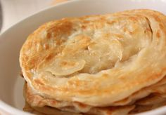 Roti canai is an Indian food that has been popularized in Malaysia as a 24 hour food, literally, day in and day out and is swiped, slurped . Food T, Food And Drink, Roti Canai Recipe, Roti Bread, Malay Food, Famous Recipe, Puff Pastry Recipes, Outdoor Food, Food Stall