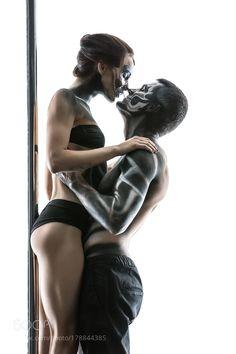 Posing of pole dance couple in studio by bezikus