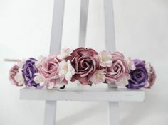 I really like this flower crown with the light mauve roses mixing with red mauve and purple altogether. Small accents flowers are also added in between