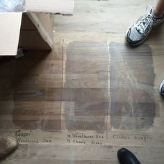 While I jetted off to #alberta for a quick weekend visit, our clients and Brandon checked out hardwood stain samples. Love this pic that they sent with stain options (and a snippet of everyone's shoes). We have a favourite - does anyone else care to weigh in? #dcskmr #davisconstructionservices #weathereoak #classicgray #hardwoodfloors #whiteoak #sitefinished