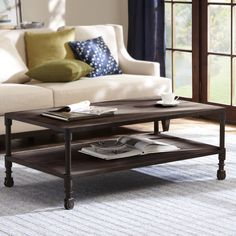 The Renate Coffee Table adds a modern look to any decor, highlighting a rich coffee reclaimed wood finish. The accent piece has a sturdy metal frame for extra style and strength and one fixed shelf.