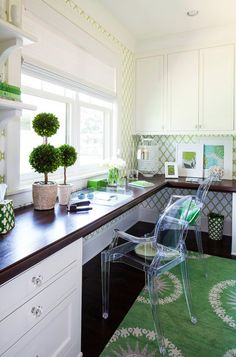 Love the desk, the concept really.. Cabinets on both ends, desk wraps around a corner of the room with a window view!