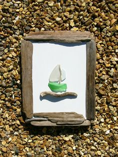 This picture has been created using natural driftwood and sea glass on a painted white background. I have spent time carefully selecting the right pieces to give a feel of simplicity and harmony. For an added touch, I have added a freshwater pearl in the bottom right hand corner of the frame.    The driftwood and sea glass I have collected from the east coast of Scotland.    This picture measures 9.5x7 inches.