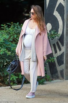 Bumping along nicely: Jessica Alba showed off her beautiful baby bump as she headed to mee...