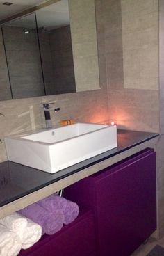 Eggplant furniture, cement bathroom