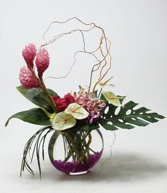 Avante Gardens Florist.      Large tropical vase arrangement for a birthday... featuring Ginger, Mokara orchids, Hot Lady roses, Limelight anthurium, hydrangea and tropical foliage
