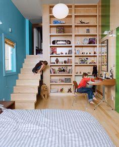 vintage herman miller swag leg desk + staircase design + built-in bookcase in bedroom via dwell