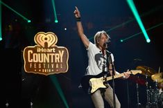 Keith Urban Photos - Singer Keith Urban performs onstage during the 2016 iHeartCountry Festival at The Frank Erwin Center on April 30, 2016 in Austin, Texas. - 2016 iHeartCountry Festival at the Frank Erwin Center - Show