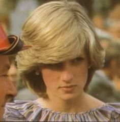 March 25, 1983: Prince Charles & Princess Diana meet the firefighters of a recent brushfire in Cockatoo, Australia where Prince Charles was presented with a helmet.