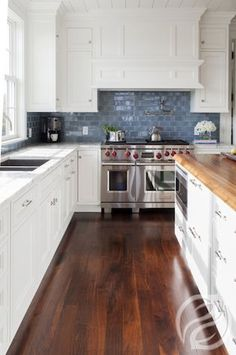 An all-white kitchen can emphasize a pop-of-color backsplash or deeply contrasting floor.
