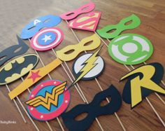 Embrace your inner Superhero and strike a pose with our Superhero Phrase Photo Prop Set!  Planning a photo booth at your next event or want to add super-flair to your family photos? Our photo props make capturing memories fun & hilarious for everyone! All photo props are made with layers of premium smooth cardstock and securely mounted on a 12 wooden dowel. They are delivered fully assembled and ready for posing! This 6 piece set contains:  ~2 BAM! ~2 POW! ~2 ZAP!   Looking to customize c...