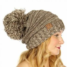 A must have for winter! Oversized CC Brand slouchy pompom beanie in a gorgeous marbled brown color. 100% Acrylic