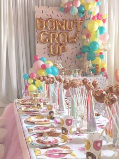 "Donut party tables from a ""Donut"" Grow Up 1st Birthday Party on Kara's Party Ideas 
