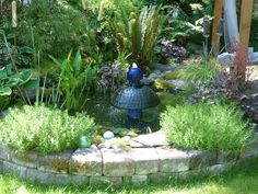 My first fish pond I did.  It is made from a 300 gl.  Rubbermaid stock tank dug into the ground.  Pond by Kathleen Scott (and Husband)