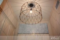 Kirsten McLean light fixture created with a wire storage basket, HD pendant kit and Edison bulb.