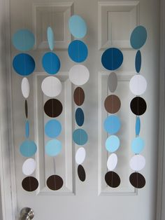 Paper Garland, Blue, Brown, and White Circles Dangling Decorations, Baby Shower Decorations, Birthday, Wedding, Showers. $22.00, via Etsy.