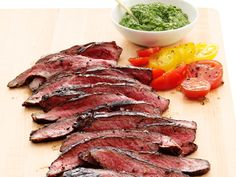 Flank Steak with Salsa Verde : Slather slices of budget-friendly flank steak and summer-ripe tomatoes with our parsley-and-scallion salsa verde.