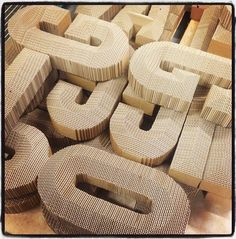 Cardboard signage created for Selfridges Christmas Displays. Giles Miller Studio.