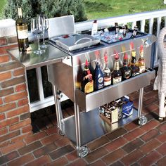 """Cocktail Cart Cocktail Cart has an insulated main ice bin with sliding cover, three compartment condiment tray. bottle well and rail, flip-up workboard/bartop, built-in bottle opener with cap catcher, towel bar and storage shelf. Heavy-duty casters with front lock wheels let you move the cart easily, indoors or out. Two drain valves. Measures 30""""h x 45 1/4""""w x 23""""d."""