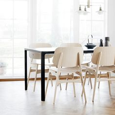 Tea is served. Take a break on the classic Søborg chair by Børge Mogensen accompanied by Welling/Ludvik's minimalistic Mesa Table.