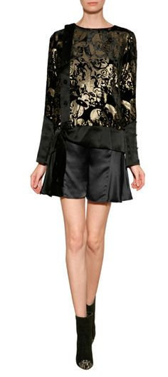A cheeky alternative to the essential black skirt, these shorts from Anna Sui feature a flared leg and shimmering satin #Stylebop