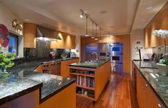 Modern Kitchen with Simple granite counters, Wine refrigerator, U-shaped, Flush, Simple Granite, European Cabinets