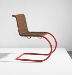 LUDWIG MIES VAN DER ROHE Early side chair, model no. MR 10, designed 1927, manufactured circa 1935 Painted tubular steel, woven cane. 31 1/4 x 18 1/2 x 28 3/4 in. (79.4 x 47 x 73 cm) Manufactured by Gebrüder Thonet.