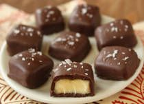 Chocolate-Covered Brie Bites are decadent squares of brie cheese covered in rich chocolate and crunchy sea salt.
