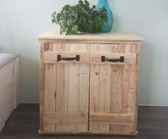 Want to hide that ugly garbage bin? 3 free pallets, some scraps of OSB, 1 afternoon and you can!
