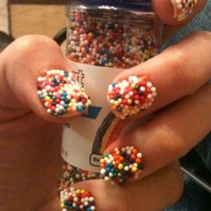 My version of the caviar manicure. Rather than get put on a waiting list for a $20 bottle of polish I went to Walmart and bought $.83 bottle of cupcake sprinkles!! And used lots of top coat!! [Pinterest Addict]