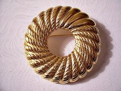 Monet Swirl Rib Pin Brooch Gold Tone Vintage Smooth Lined Round Ring from PrettyJewelryThingsStore