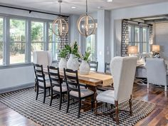 Traditional Dining Room with Carpet, Pendant Light, Hardwood floors, High ceiling