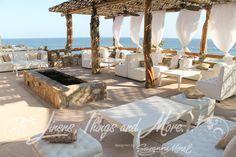 Beach style lounge decor for a wedding designed by Matthew Robbins at the Esperanza Resort in Cabo San Lucas.