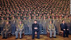North Korean leader Kim Jong Un, center, poses with chiefs of branch social security stations in this undated picture released by North Korea's official news agency on November 27, 2012.