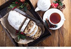 Christmas stollen with dried fruits and marzipan served with tea and decorations…