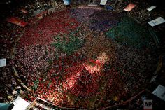"""Members of """"Vella de Xiquets de Valls"""" try to complete their human tower during the 26th Human Tower Competition in Tarragona, Catalonia, on Sunday, Oct. 2, 2016. (AP Photo/Emilio Morenatti)"""