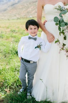 Rustic-chic ring bearer, gray trousers, bowtie, black Converse sneakers // Anna Marks Photography