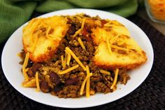 South of the Border Tamale Pie Filling Ingredients:  2 pounds lean ground beef 2 Tablespoons chili seasoning 1/4 teaspoon onion powder 2 cans (14 1/2 ounces each) stewed tomatoes, cut-up 1 can (14 1/2 ounces) kidney beans , drained and rinsed 1 can (4 ounces) chopped green chiles 1/2 cup water   Cornbread Topping Ingredients:  1 box (8 1/2 ounces) corn muffin mix 1 cup shredded Cheddar cheese