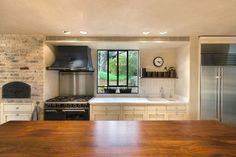 looking out over a solid wood countertop into an open kitchen for all about wood countertops